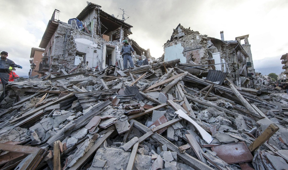 epa05508246 Search and rescue teams survey the rubble in Amatrice, central Italy, 24 August 2016, following a 6.2 magnitude earthquake, according to the United States Geological Survey (USGS), that struck at around 3:30 am local time (1:30 am GMT). The quake was felt across a broad section of central Italy, including the capital Rome where people in homes in the historic center felt a long swaying followed by aftershocks. According to reports at least 21 people died in the quake, 11 in Lazio and 10 in Marche regions.  EPA/MASSIMO PERCOSSI